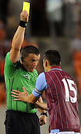 Aston Villa midfielder Ashley Westwood (15) pleads his case with referee Sorin Stoica after being issues a yellow card during the second  half of the BBVA Compass Dynamo Charities Cup against the Houston Dynamo, Saturday, July 26, 2014, at BBVA Compass Stadium in Houston. (Photo: Eric Christian Smith/For the Chronicle)
