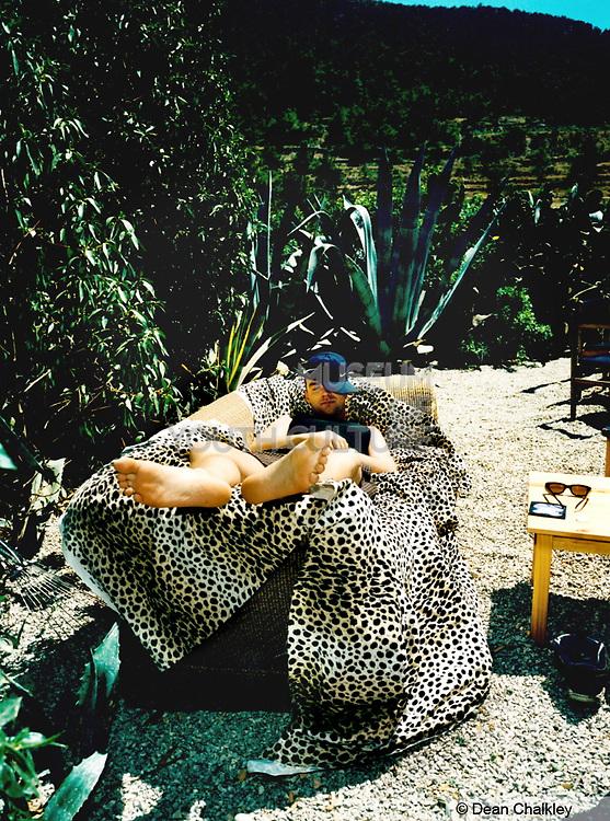Man sleeping outside on a sofa Ibiza 1998