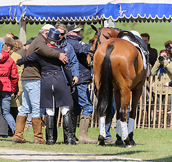 Zara Phillips receives a hug from her Father Mark phillips after she finished her dressage test on  HIGH KINGDOM at the Mitsubishi Motors Badminton Horse Trials, Saturday May 4th 2013. Photo by:  Nico Morgan / i-Images