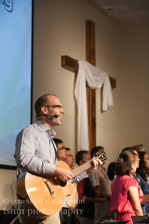 Pastor John Eckrote and the choir leading the Evangelical Church of Bangkok (ECB) during the Easter service on 24 April 2011 in Bangkok, Thailand