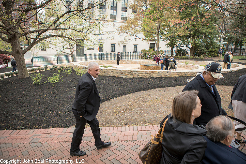 Monacan Chief, Dean Branham, left, surveys the new monument, Mantle: Virginia Indian Tribute, built on the Virginia State Capitol Square, in Richmond, Virginia, on Tuesday, April 17, 2018. John Boal Photography