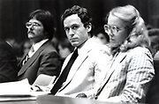 Ted Bundy Murder Trial - Miami - Ted Bundy with defense attorney Margaret Good at the defense table. Theodore Robert Bundy was an American serial killer, kidnapper, rapist, burglar, and necrophile who assaulted and murdered numerous young women and girls during the 1970s and possibly earlier. After more than a decade of denials, he confessed to 30 homicides that he committed in seven states between 1974 and 1978.