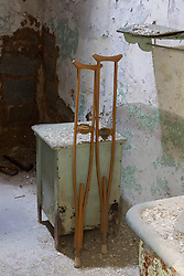crutches in an abandoned prison