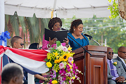 "Lorna Freeman, left, and Melita Etienne perform ""Valiant Virgin Isles"" written by Gylchris Sprauve.  St. Thomas Swearing-In Ceremony for the 32nd Legislature of the US Virgin Islands.  Emancipation Garden.  St. Thomas, VI.  9 January 2017.  © Aisha-Zakiya Boyd"
