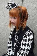 "Costume Play Checkerboard - A wide variety of ""costume play"" creations are to be seen every Sunday in Harajuku, Tokyo's fashion quarter.  It makes you wonder, however,  what they wear to work on Monday mornings..."