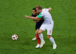 MOSCOW, RUSSIA - Wednesday, July 11, 2018: Croatia's Dejan Lovren and England's captain Harry Kane during the FIFA World Cup Russia 2018 Semi-Final match between Croatia and England at the Luzhniki Stadium. (Pic by David Rawcliffe/Propaganda)
