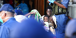 South Africa - Cape Town - 02 April  2020 -Refugees who have been residing at the Methodist Church since October 2019 have been removed to a new shelter in Bellville.The police has to force their way in at the church by breaking down the church doors,then bussed them to Bellville.These ferugees were taken in by Rev Micheal Story after they were forcefully being removed from the NHCR offices in 2019.Photographer: Phando Jikelo/African News Agency(ANA)