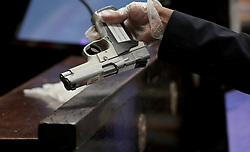 September 18, 2018 - Chicago, Illinois, U.S. - Jason Van Dyke's 9mm semiautomatic Smith and Wesson, used in the killing of Laquan McDonald, appears at the trial for the shooting death of McDonald on Tuesday, Sept. 18, 2018 at the Leighton Criminal Court Building. (Credit Image: © Antonio Perez/Chicago Tribune/TNS via ZUMA Wire)