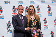 Los Angeles Mayor Eric Garcetti, left, receives the first commemorative, full-color souvenir book to mark the 90-year history of the TCL Chinese Theatre, on Monday, July 24, 2017, in Los Angeles  (Photo by Ringo Chiu)<br /> <br /> Usage Notes: This content is intended for editorial use only. For other uses, additional clearances may be required.