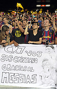 Barca fans mock Ronaldo.  A sign depicting Messi caressing Ronaldo's head as he kneels before his messiah. Barcelona v Real Madrid, Supercopa first leg, Camp Nou, Barcelona, 23rd August 2012...Credit - Eoin Mundow/Cleva Media.