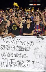Barca fans mock Ronaldo.  A sign depicting Messi caressing Ronaldo's head as he kneels before his messiah. Barcelona v Real Madrid, Supercopa first leg, Camp Nou, Barcelona, 23rd August 2012...Credit - Eoin Mundow/Cleva Media.