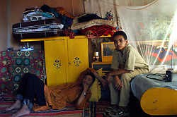 Niger,Agadez,2007. Family members relax inside Takita Ixa's room at Mohammad Ixa's home in Agadez.