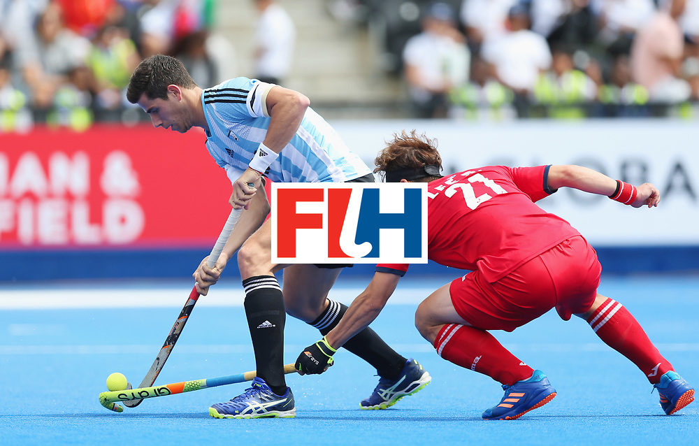 LONDON, ENGLAND - JUNE 15:  Joaquin Menini of Argentina and Seunghoon Lee of South Korea battle for the ball during the Pool A match between Korea and Argentina on day one of Hero Hockey World League Semi-Final at Lee Valley Hockey and Tennis Centre on June 15, 2017 in London, England.  (Photo by Alex Morton/Getty Images)