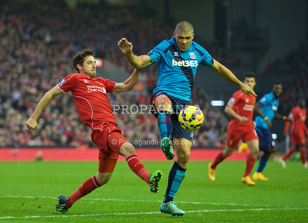 LIVERPOOL, ENGLAND - Saturday, November 29, 2014: Liverpool's Joe Allen in action against Stoke City's Jonathan Walters during the Premier League match at Anfield. (Pic by David Rawcliffe/Propaganda)
