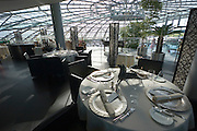 "Hangar-7; the spectacular home of the Flying Bulls (""Red Bull"" owner Didi Mateschitz' collection of classic airplanes) next to Salzburg W.A. Mozart airport. Ikarus Restaurant, under patronage of Eckart Witzigmann, each month starring a different internationally famous chef."