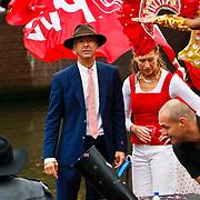 NLD/Amsterdam/20100807 - Boten tijdens de Canal Parade 2010 door de Amsterdamse grachten. De jaarlijkse boottocht sluit traditiegetrouw de Gay Pride af. Thema van de botenparade was dit jaar Celebrate, politicus Ronald Plasterk