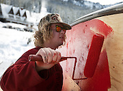 Aaron Fraher puts a fresh coat of paint on a rail box at the Brighton Ski Resort, opening on November 13th for the season, Monday, Nov. 12, 2012.