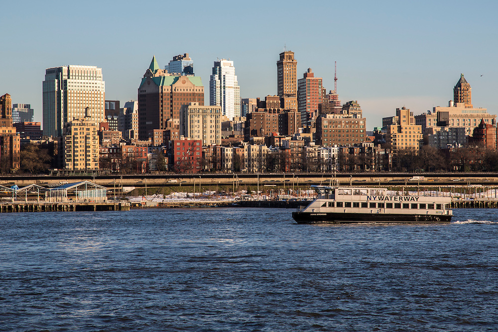 A white NY Waterway boat sails along the East River past buildings of Brooklyn, as seen from Pier 6, Manhattan, New York City, New York, United States of America. (photo by Andrew Aitchison / In pictures via Getty Images)