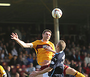 Motherwell's Stephen McManus heads clear from Dundee's David Clarkson - Motherwell v Dundee, SPFL Premiership at Fir Park<br /> <br />  - &copy; David Young - www.davidyoungphoto.co.uk - email: davidyoungphoto@gmail.com