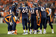 The Denver Broncos offense huddles and calls a play during the NFL week 4 regular season football game against the Kansas City Chiefs on Monday, Oct. 1, 2018 in Denver. The Chiefs won the game 27-23. (©Paul Anthony Spinelli)
