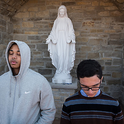 Christian Brothers College senior Corey States, left, and freshman Alex Ramirez prayed at the school's marian grotto in Town and Country, Mo. on Wednesday, Mach 14, 2018. They were among several dozen students who prayed as part of the national movement of school walkouts to call for gun policy reform and the end of violence. (Photo by Teak Phillips | St. Louis Review | teakphillips@archstl.org | twitter: @TeakPhillips)