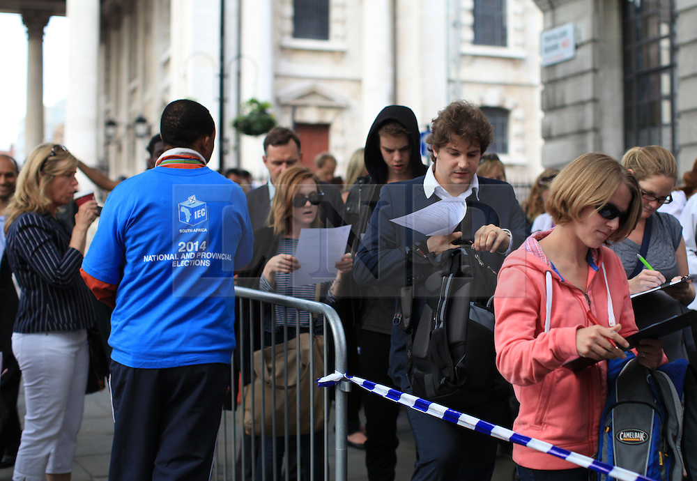 © Licensed to London News Pictures. London, UK. 30/04/2014. London, UK.  South African citizens queue outside South Africa House, of Trafalgar Square, to vote ahead of the 2014 South African general election, which will be held on 7 May 2014.Photo credit: Isabel Infantes /LNP
