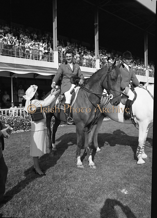 The Dublin Horse Show.1982.07.08.1982.08.07.1982.7th August 1982...The Dublin Horse Show..R.D.S., Ballsbridge, Dublin.The winners of the Aga Khan team trophy were Great Britain. The shows' leading rider was Mr Harvey Smith, Great Britain..In picture Mr Harvey Smith accepts his team award from Mrs Hely Hutchinson.