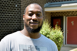 Resident Terrin Walker after chatting with Tanzie Youngblood as the candidate is canvassing ahead of the June 5 Primaries, at a Brigdeton, NJ low-income housing project, on May 26, 2018.