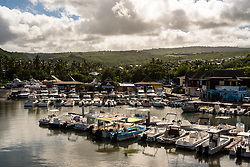 St. Gilles les Bain, Reunion -- January 20, 2018 -- Pleasure boats are anchored in a small marina on the island of Reunion. Editorial use only.