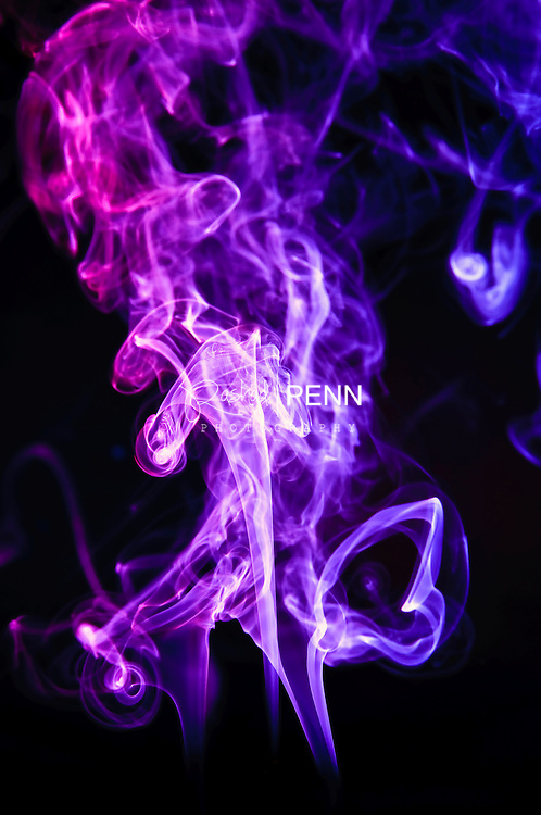 Images of smoke mixed with colored light to create apealing abstract art.