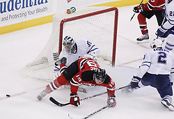 Jan 29, 2010; Newark, NJ, USA; Toronto Maple Leafs defenseman Luke Schenn (2) takes a tripping penalty on New Jersey Devils center Travis Zajac (19) during the overtime period at the Prudential Center. The Devils won 5-4 in overtime.