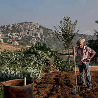 A farmer takes break  in Mount Lebanon, farms his agricultural land.
