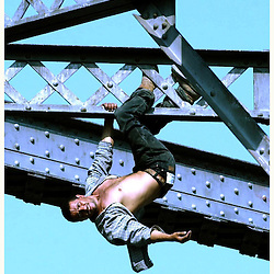 Whittier: A man threatening to kill himself dangles from the top of the Union Pacfic Railroad bridge at Five Points intersection in Whittier,Calif., August 27,2002.The man was rescued after 8 hours on top of the bridge.<br /> (Whittier Daily News Staff Photo Keith Birmingham/City