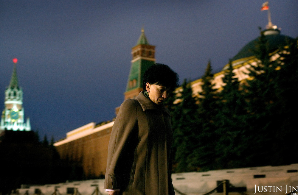 A woman walks in Moscow's Red Square past the Kremlin, the seat of the government where President Vladimir Putin works.