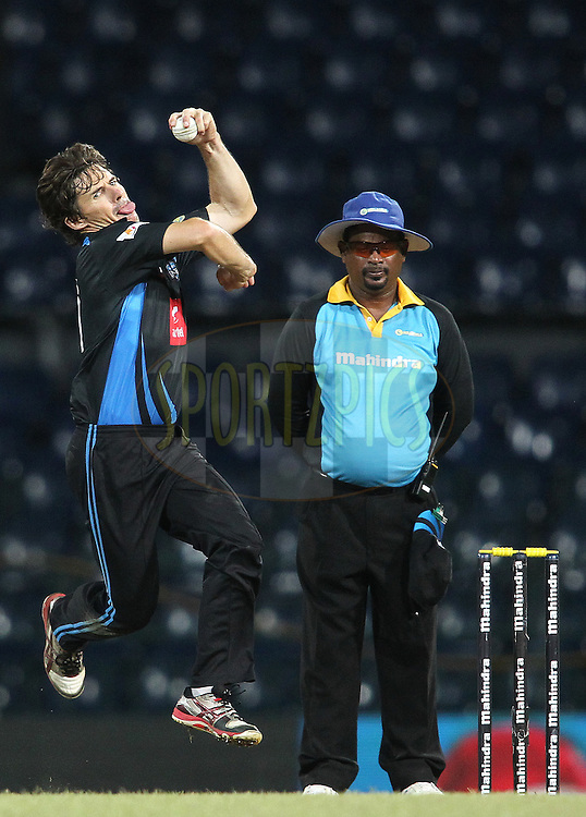 Brad Hogg of Wayamba United sends down a delivery during match 20 of the Sri Lankan Premier League between Ruhuna Royals and Wayamba United held at the Premadasa Stadium in Colombo, Sri Lanka on the 26th August 2012. .Photo by Shaun Roy/SPORTZPICS/SLPL