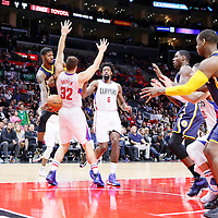 02 December 2015: Indiana Pacers forward Paul George (13) passes the ball around Los Angeles Clippers forward Blake Griffin (32) to Indiana Pacers center Ian Mahinmi (28) during the Indiana Pacers 103-91 victory over the Los Angeles Clippers, at the Staples Center, Los Angeles, California, USA.