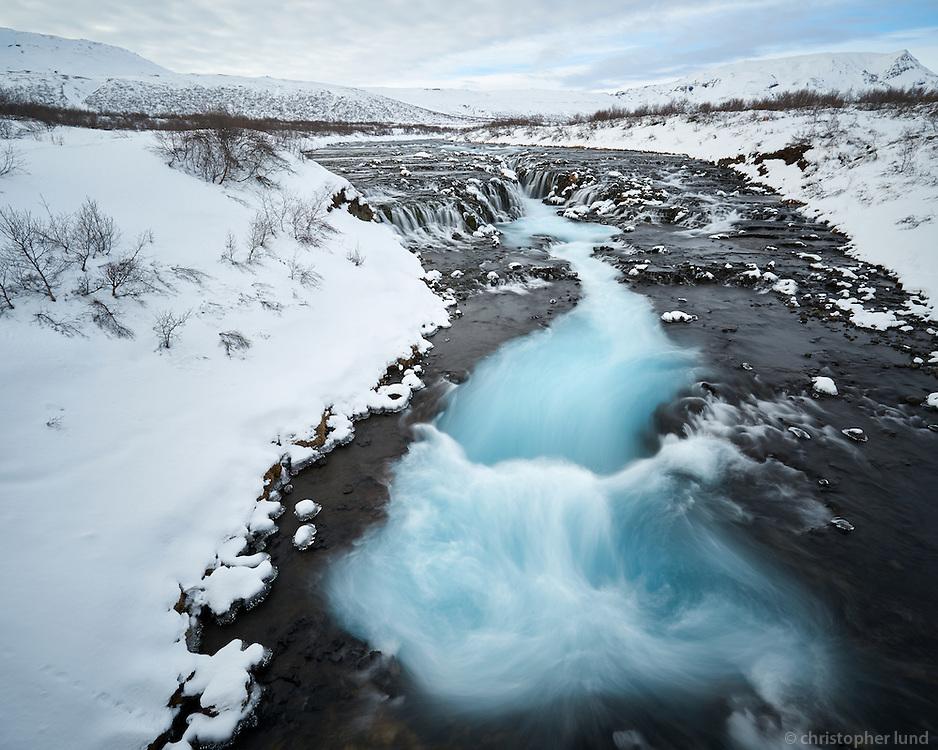 Brúarfoss waterfall in winter, South Iceland.
