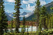 The Rockwall rises above the Kootenay River, as seen from the Paint Pots hikers' bridge in Kootenay National Park, British Columbia, Canada.