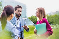 Business people discussing plans on meeting outdoor
