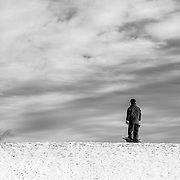 A lone sledder at the top of the hill at Nara Park in Acton, MA.