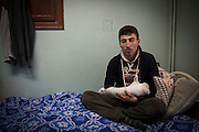 "Isaa, 21, injured, two of his fingers were cut off by BKC explosive bullets during a battle against ISIS, January 27, 2014. He has fought in the Liwa Al Tawhid for 3 years. He said: ""Bashar al-Assad and ISIS are the same."" One of his brothers is a prisoner of ISIS, he was a plumber before the revolution. He does not look back, he accepts his fate and he want to return to the armed struggle as soon as he can.<br /> <br /> Isaa, 21 ans, blessé, il a des doigts coupés par des balles explosives d'un BKC pendant une bataille contre ISIS, le 27 janvier 2014. Il combattait dans le Liwa Al Tawhid depuis 3 ans. Il dit :  ""Bachar el-Assad et ISIS c'est pareil"". Un de ses frères EST prisonnier d'Isis, il était un plombier avant la révolution. Il ne regarde pas en arrière; il accepte son sort et il retourne à la lutte armée des qu'il peut."