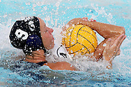 US player Heather Moody (9) smothers Australian player Naomi Castle (4) during the  United States vs Australian bronze medal match in the Women's Water Polol at theOlympicv Aquatic Centre in Athens Thursday 26 August 2004.  The US won 6 to 5. (Photo by Patrick B. Kraemer / MAGICPBK)