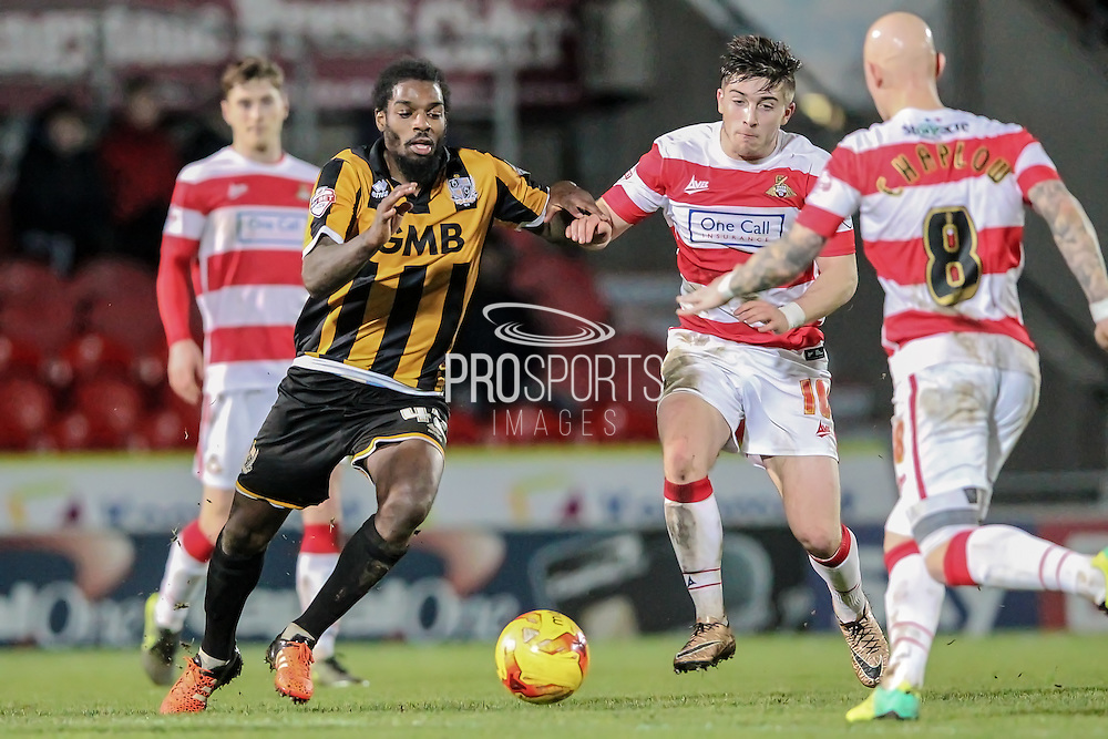 Anthony Grant (Port Vale) runs to get to the ball ahead of Richard Chaplow (Doncaster Rovers)  and Lynden Gooch (Doncaster Rovers) during the Sky Bet League 1 match between Doncaster Rovers and Port Vale at the Keepmoat Stadium, Doncaster, England on 26 January 2016. Photo by Mark P Doherty.