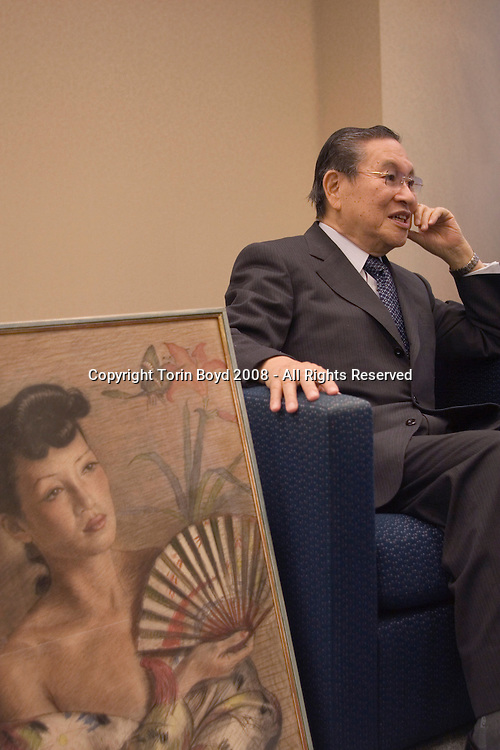 "This is Norio Ohga, a top executive with the Sony Corporation who's current title is ""Executive Advisor"". He is seen here with a painting by a Japanese artist done in 1939 of his friend and colleague Michiko Tanaka, the Japanese actress, opera singer and music professor who introduced Ohga to the Berlin arts and culture scene in the 1930s when Ohga went there to train as an opera singer. This painting is thought to be a depiction of Tanaka as Madame Butterfly. As for Ohga's career with Sony he served as company president and CEO. Born January 29, 1930, he originally trained as an opera singer. After becoming dissatisfied with a Sony tape recorder he wrote a letter to the company criticizing them for the poor quality of the device. As a result management offered him a job. Years later he rose though the ranks to become president of Sony in 1982, and CEO in 1989. In 1994 he succeeded Sony co-founder Akio Morita as Chairman and in 1995 selected Nobuyuki Idei as the company's next president. Idei then became Co-CEO with Ohga in 1998, and in 1999 Idei become the sole CEO. Ohga's career began to wind down in 2000 when he went into semi-retirement but stayed on as Chairman of the Board. In 2003 Ohga retired from the board and became Honorary Chairman. He now serves as an advisor for the company. In addition to training as an opera singer Ohga has also been a conductor studying under the Austrian orchestra and opera conductor Herbert von Karajan. Photo taken April 14, 2008 at the former Sony Headquarters in the Kita Shinagawa district of Tokyo."