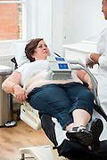 EXCLUSIVE<br /> White Dee has Lipoglaze Treatment at Harley St Clinic<br /> <br /> White Dee arrives at Lovelite Clinic, Harley St were Dee was given , Lipoglaze is a revolutionary non-surgical fat reduction treatment which literally kills off fat cells in one 50-minute session.<br /> The treatment targets fatty areas in the tummy, arms, legs, and thighs with fast results, no scaring and no pain<br /> The brand new treatment from the USA is available in the UK for the first time and is being launched by leading beauty spa treatments company LoveLite.<br /> The Lipoglaze Cryo-Lipo machine works by first gently heating and then rapidly cooling the target area. This causes the fat cells to crystallise and permanently destroys up to a third of fatty deposits per session. The body then naturally eliminates this waste tissue over the next few weeks.<br /> <br /> Photo shows:  Dee with Jourdan during treatment who conducted the procedure from LoveLite offices in Harley St.<br /> ©Exclusivepix