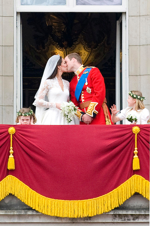 Copyright by Stefan Reimschuessel. .All Rights Reserved..reimster@gmail.com.http://reimschuessel.photoshelter.com/.Royal wedding of HRH Prince William, Duke of Cambridge and HRH Princess Catherine Elizabeth Middleton, Duchess of Cambridge at Westminster Abbey. She wore an Alexander McQueen dress, designed by Sarah Burton. After the service the couple went to Buckingham Palace by open Landau carriage and kissed on the balcony in front of the crowd.