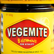 Vegemite is a dark brown Australian food paste made from brewers' yeast extract with various vegetable and spice additives. it was developed by Cyril P. Callister in Melbourne, Victoria, in 1922, as a locally sourced version of the British paste Marmite. It  has become a cultural icon. It is often put on toast.