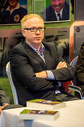 Pictured: Alex McLeish<br /> Veteran commentator Archie MacPherson was at Hampden Park today as he announced the publication of his latest book:  Adventures in the Golden Age - Scotland in the World Cup Finals 1974-1998, due to be published on 26 April  MacPherson was joined by former and  current Scotland manager Craig Brown and Alex McLeish respectivly  along with ex-Celtic, Arsenal and Scotland player Charlie Nicholas who was Archie's co-commentator at the Mexico World Cup. <br /> <br /> Ger Harley | EEm 25 April 2018