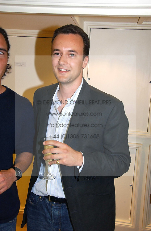 Right, the MARQUESS OF BRISTOL at an exhibition of art by Oscar Humphries entitles 'Post-Nuclear Family' held at Nutters, Lower Ground, 12 Savile Row, London on 8th June 2006.<br />