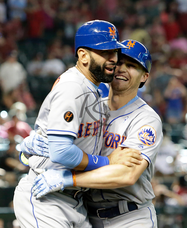 New York Mets' Brandon Nimmo, left, celebrates with Jose Bautista after hitting a two run homerun against the Arizona Diamondbacks in the ninth inning during a baseball game, Sunday, June 17, 2018, in Phoenix. (AP Photo/Rick Scuteri)